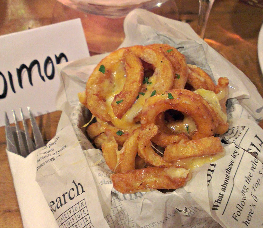 curly fries with cheese at Butters Cafe
