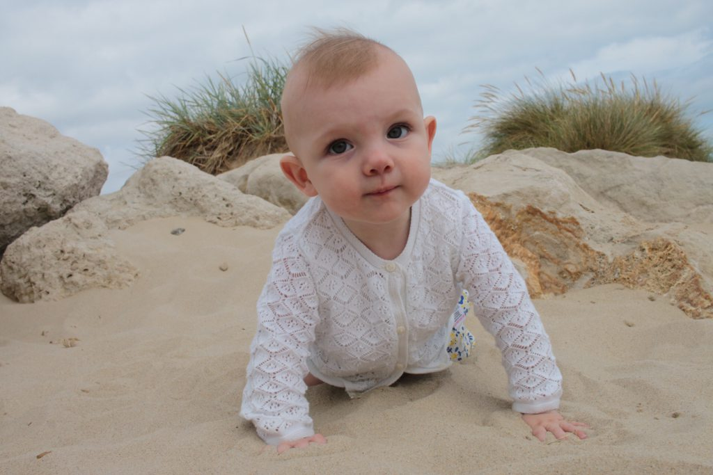 Eleanor playing in the sand at Mudeford, Dorset