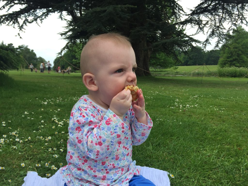 Eleanor eating her picnic at The Vyne National Trust