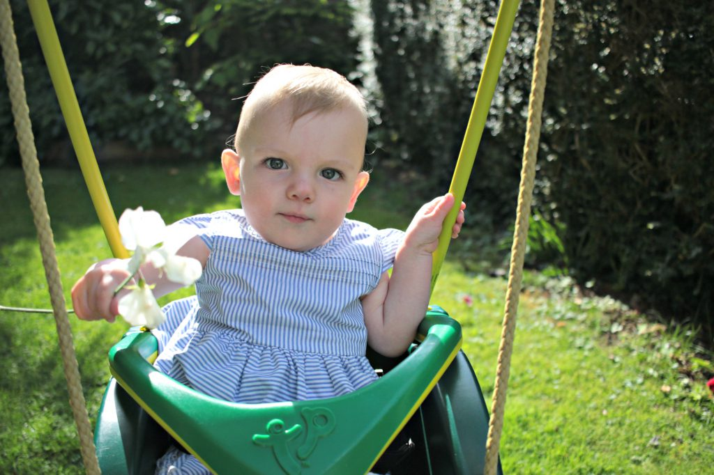 Eleanor at my parents for a BBQ playing in the swing