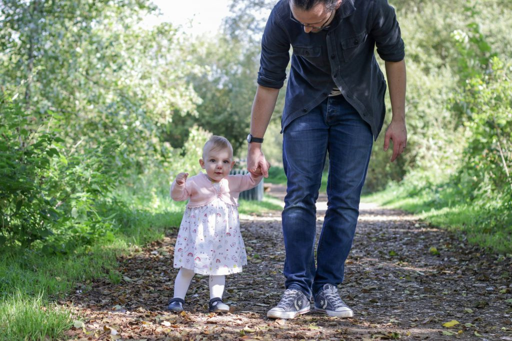 Eleanor and Daddy walking by the lakes