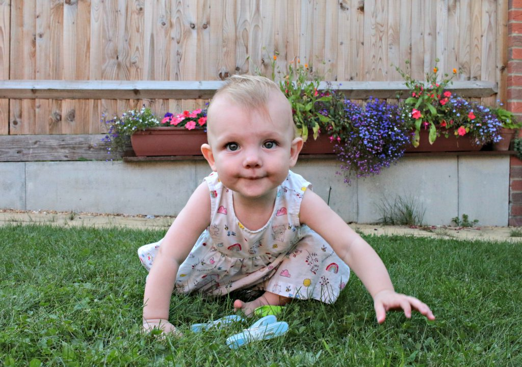 Eleanor crawling in the garden