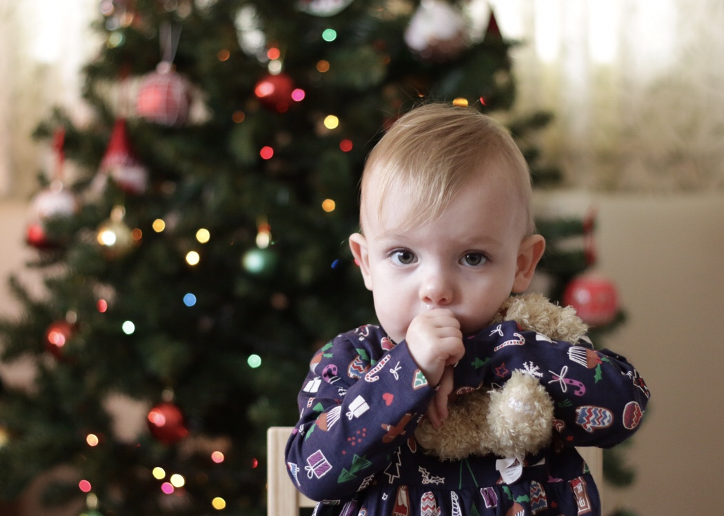 Eleanor in front of the Christmas tree