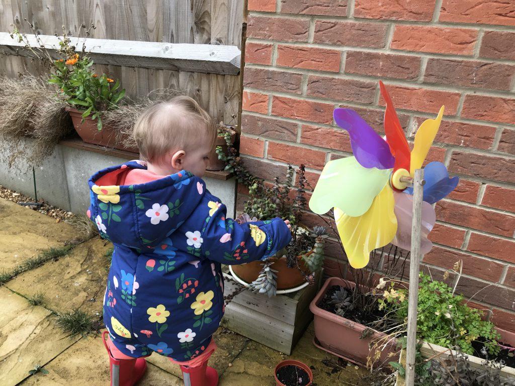 Eleanor exploring the plants in the garden