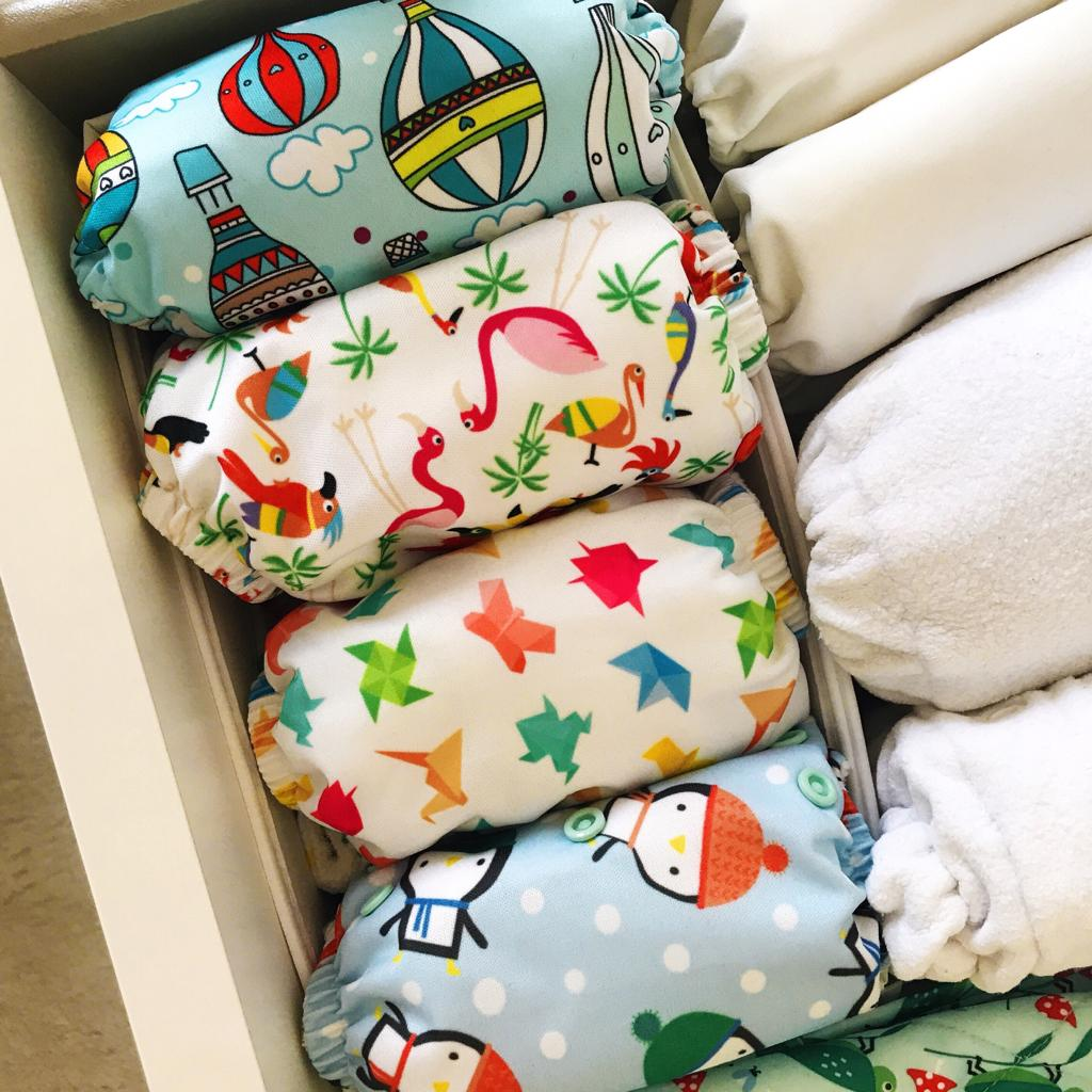 Cloth nappies in a draw. How to get started with cloth nappies.